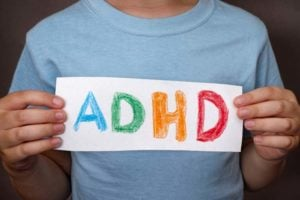 Natural Solutions for ADD and ADHD - adhd child holding notice