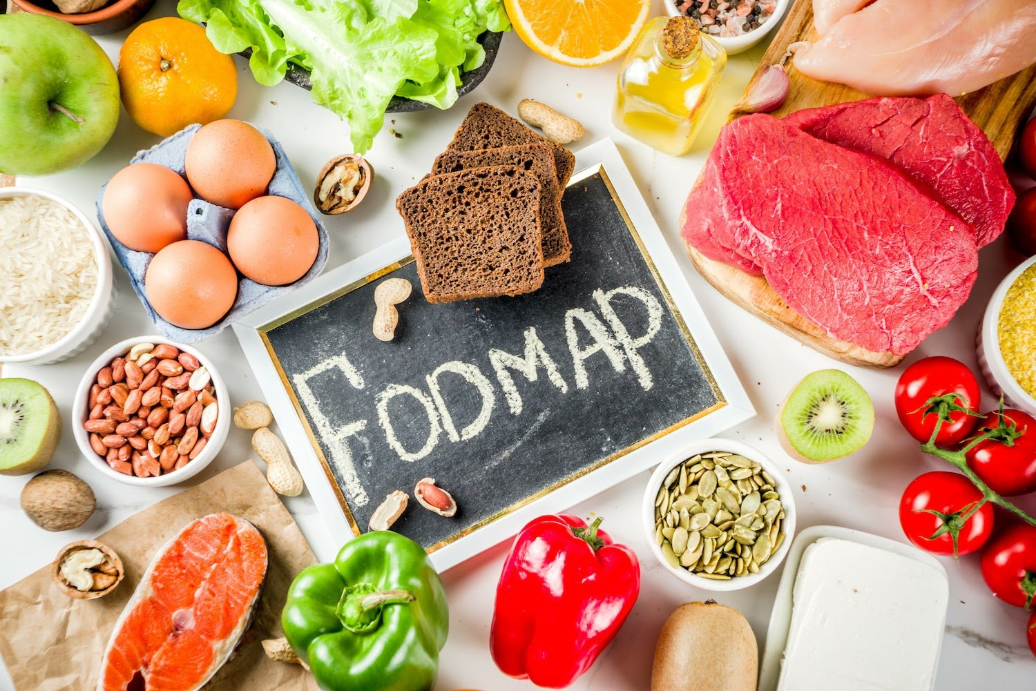 """Low FODMAP Diet: A sign that reads """"FODMAP"""" surrounded by foods related to the diet"""