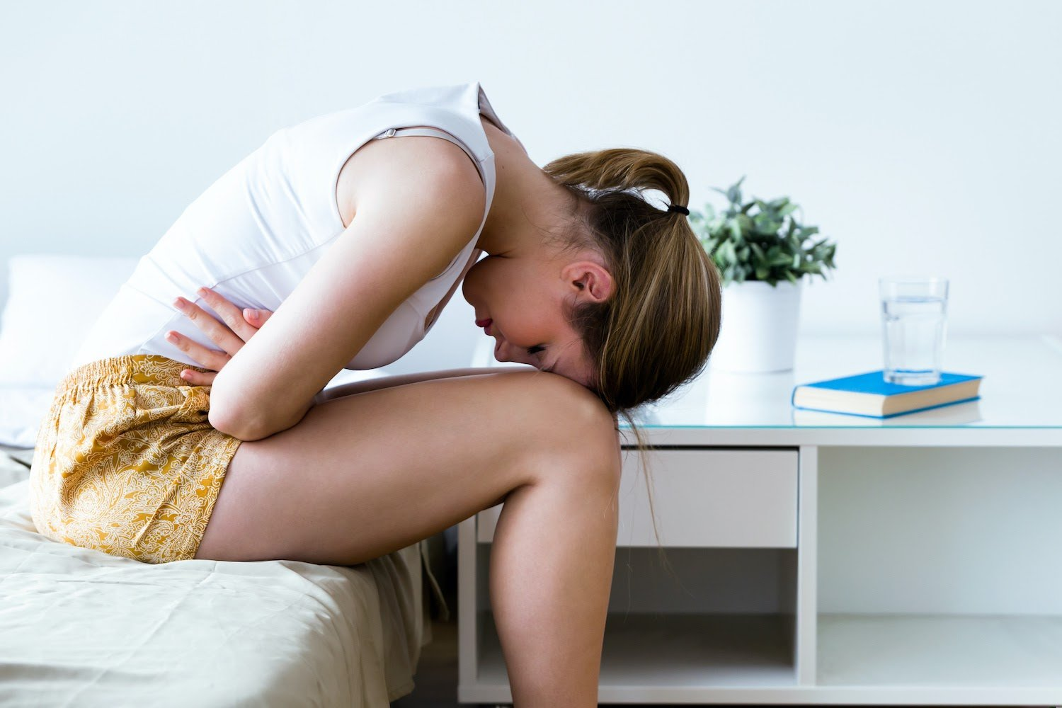 IBS probiotics: A woman doubled over from stomach pain
