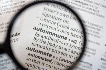 Magnifying glass over definition of autoimmune