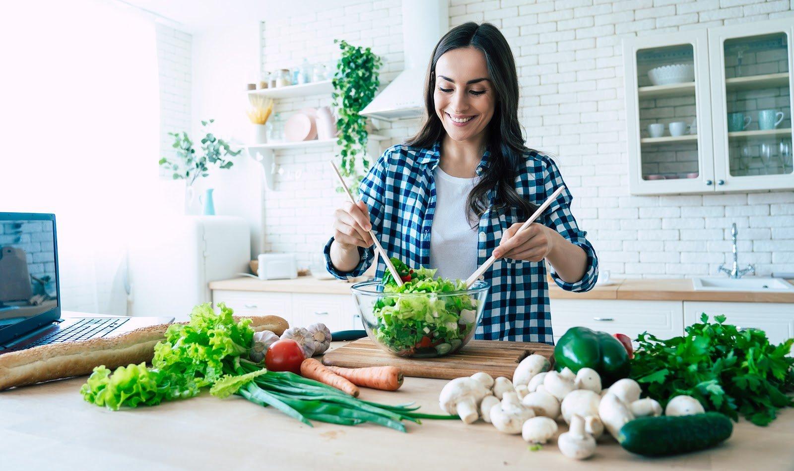 ibs diet: woman preparing vegetable salad in the kitchen
