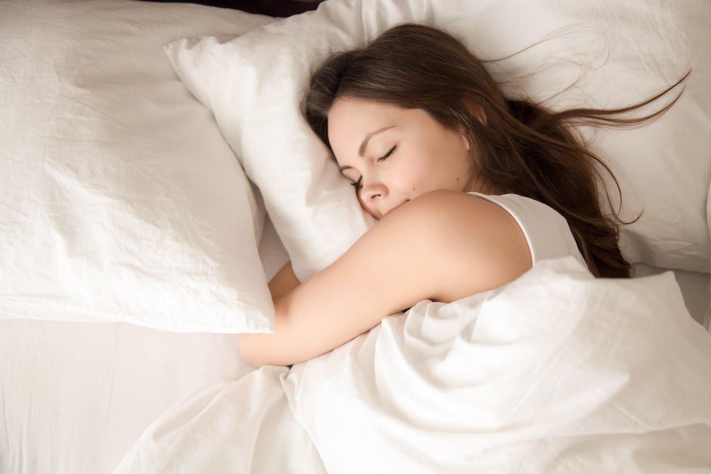 woman in bone broth diet sleeping well in bed