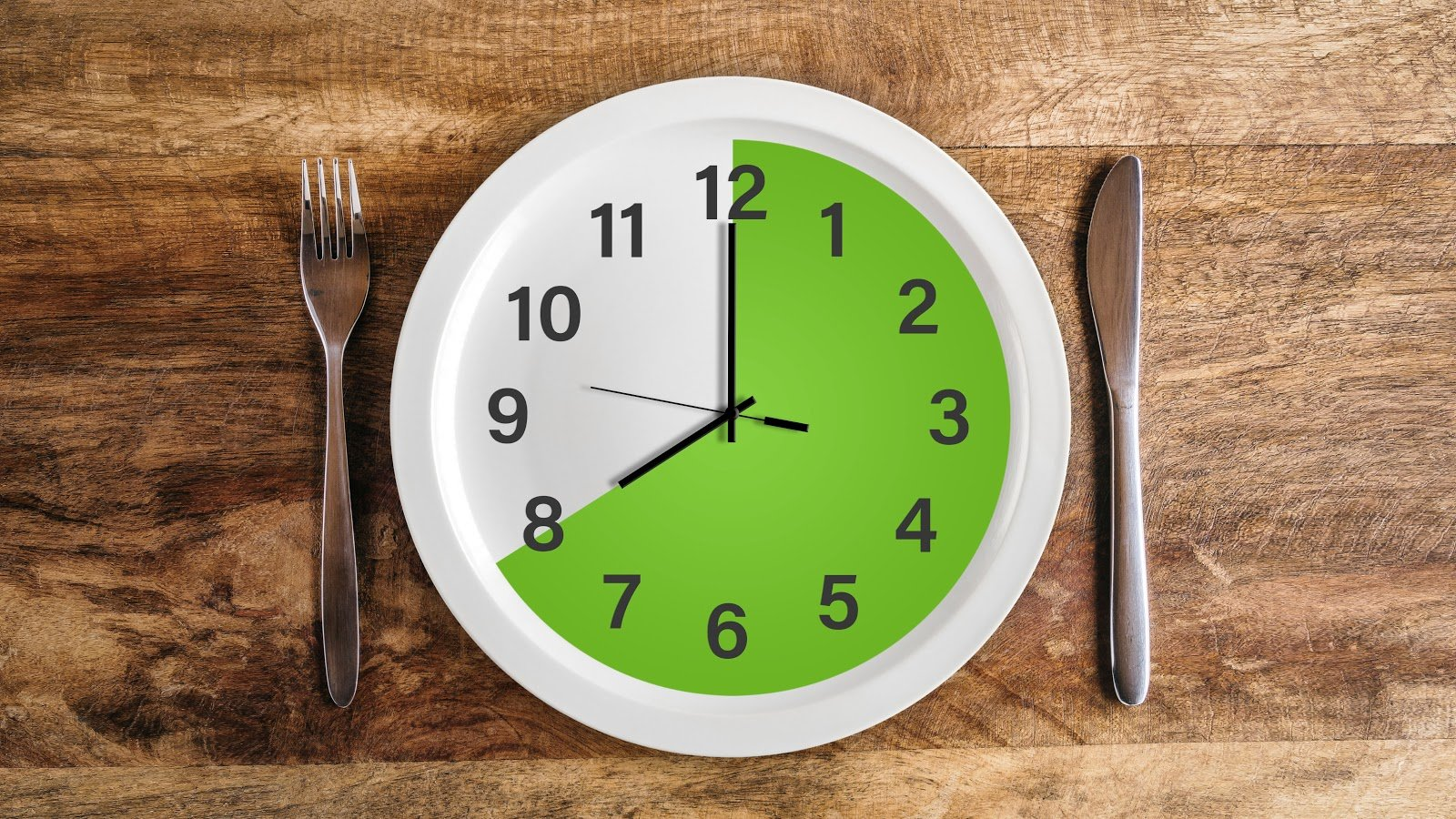 Bone broth fast: a clock with a knife and fork in the table