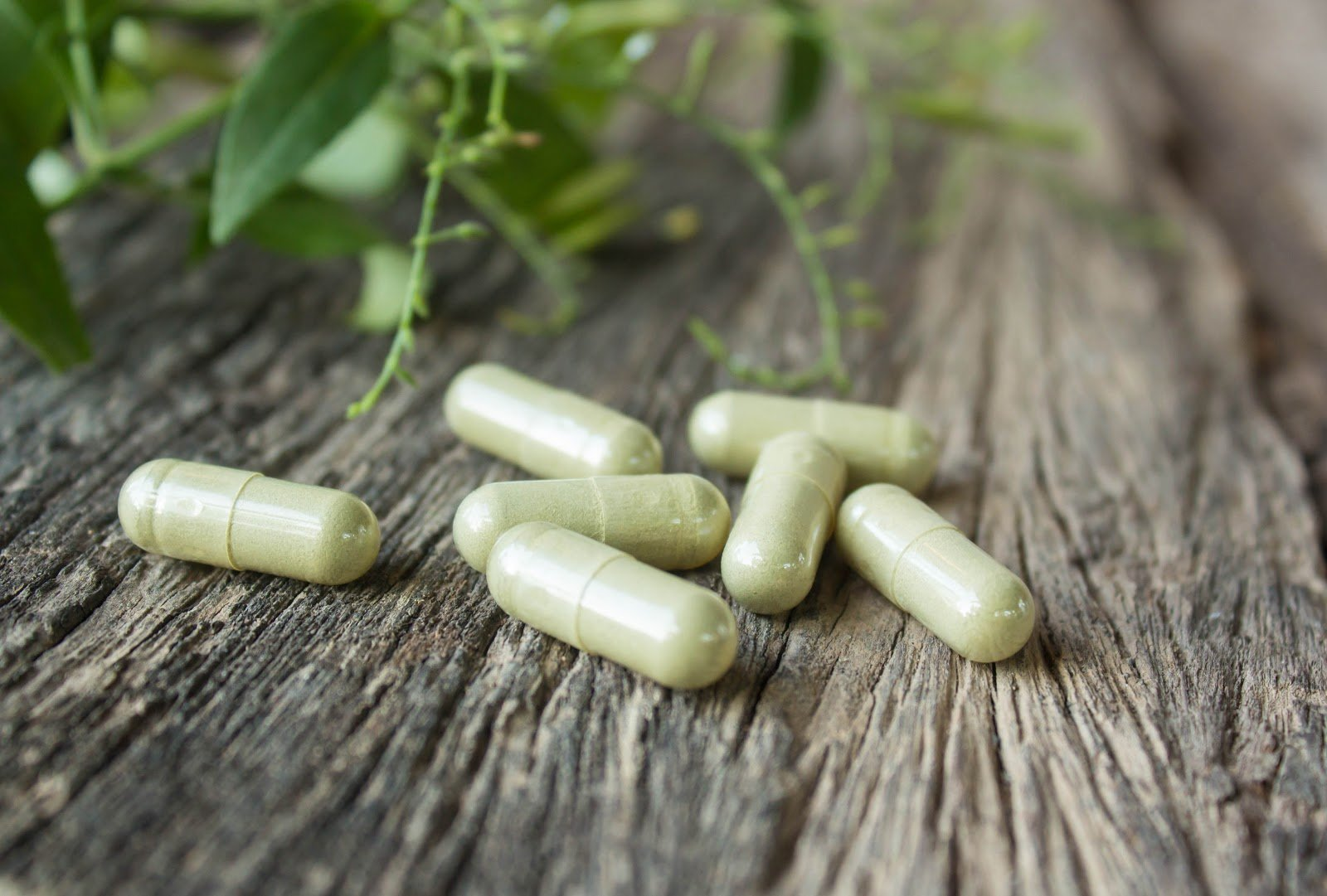 Supplements on a wooden table