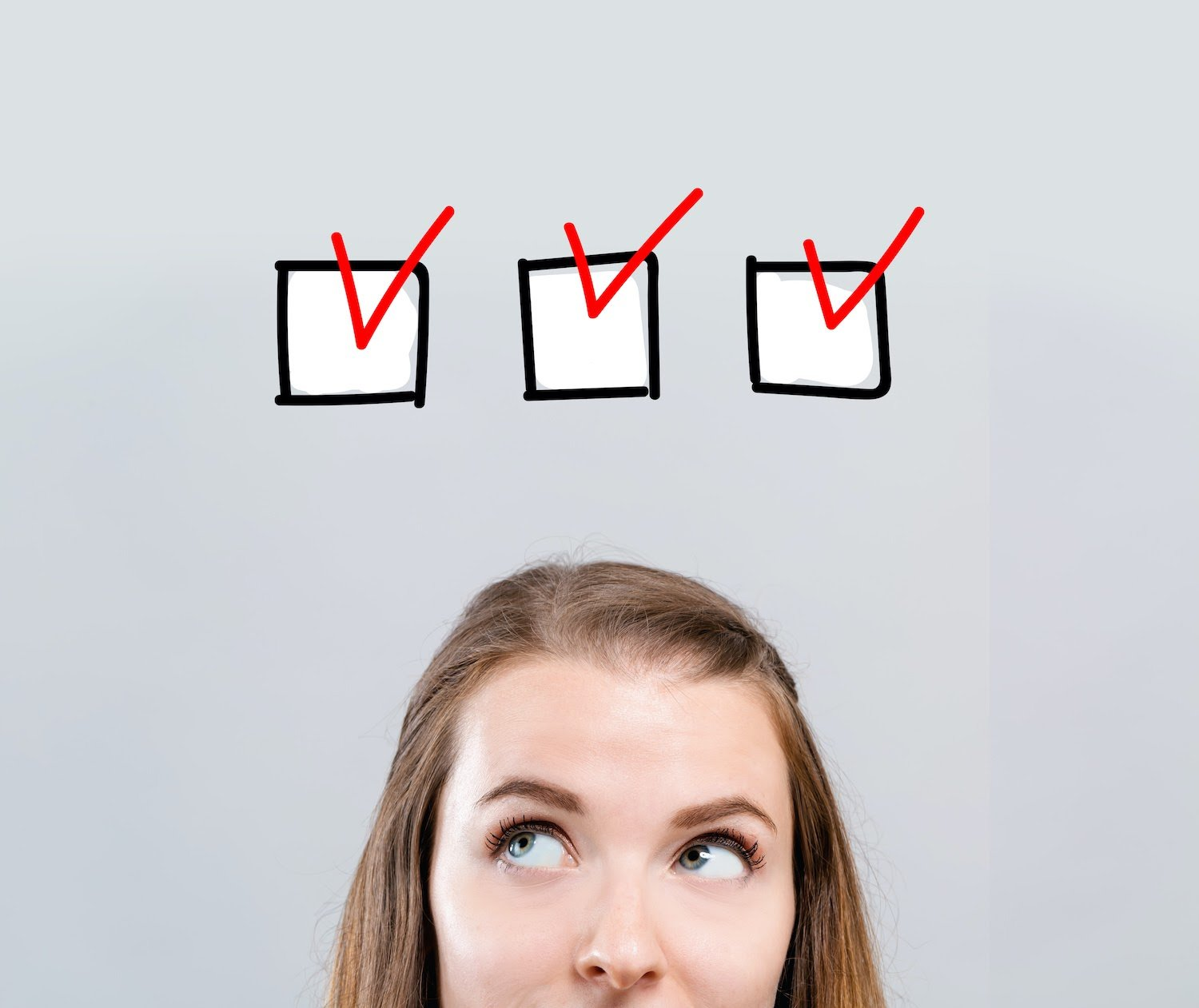 Woman looking upward with a checklist above her head