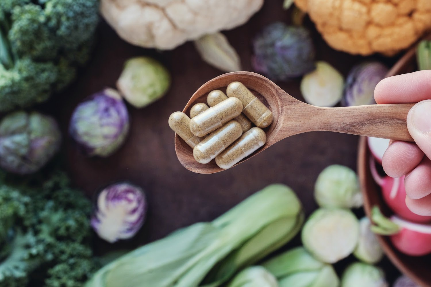 Digestive enzyme supplements in a spoon