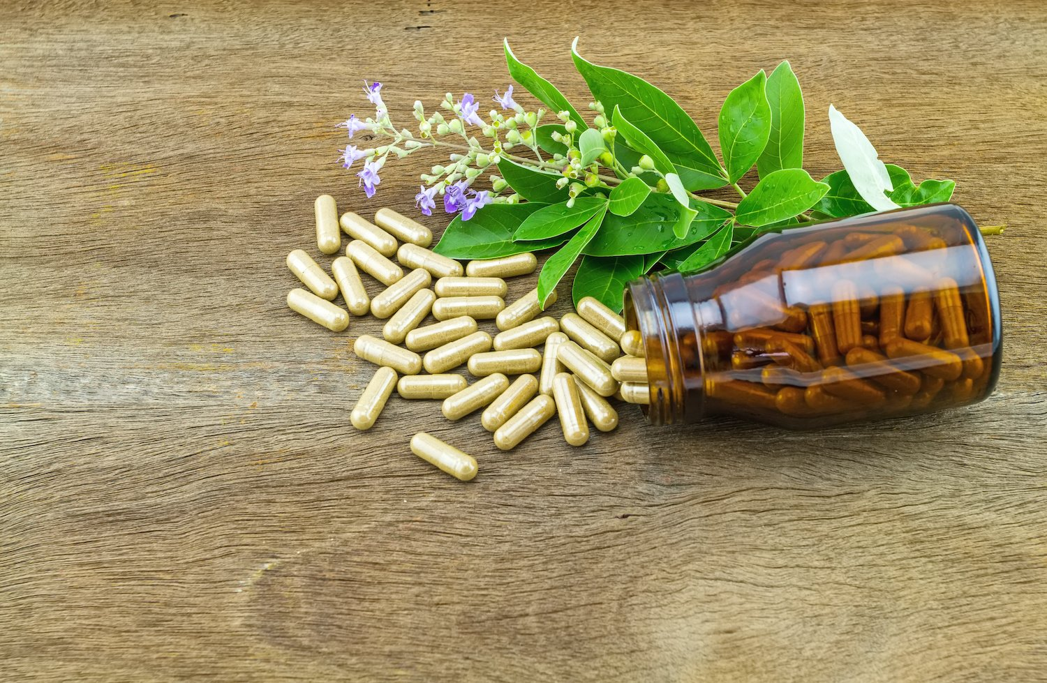 Natural remedies for menstrual cramps: Herbal supplements with a bottle, flowers, and leaves
