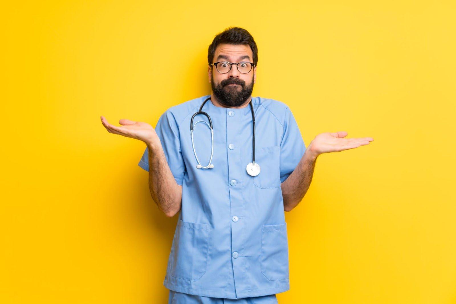 brain fog: Shrugging doctor wearing scrubs against a yellow background