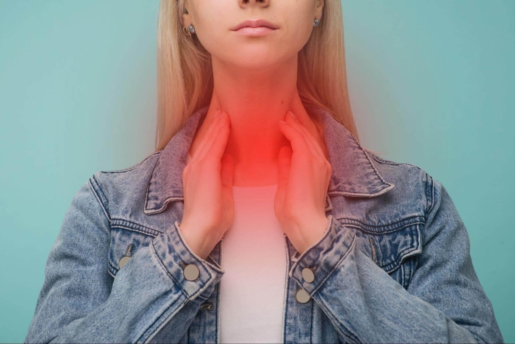 LPR symptoms: Woman in pain, touching her neck