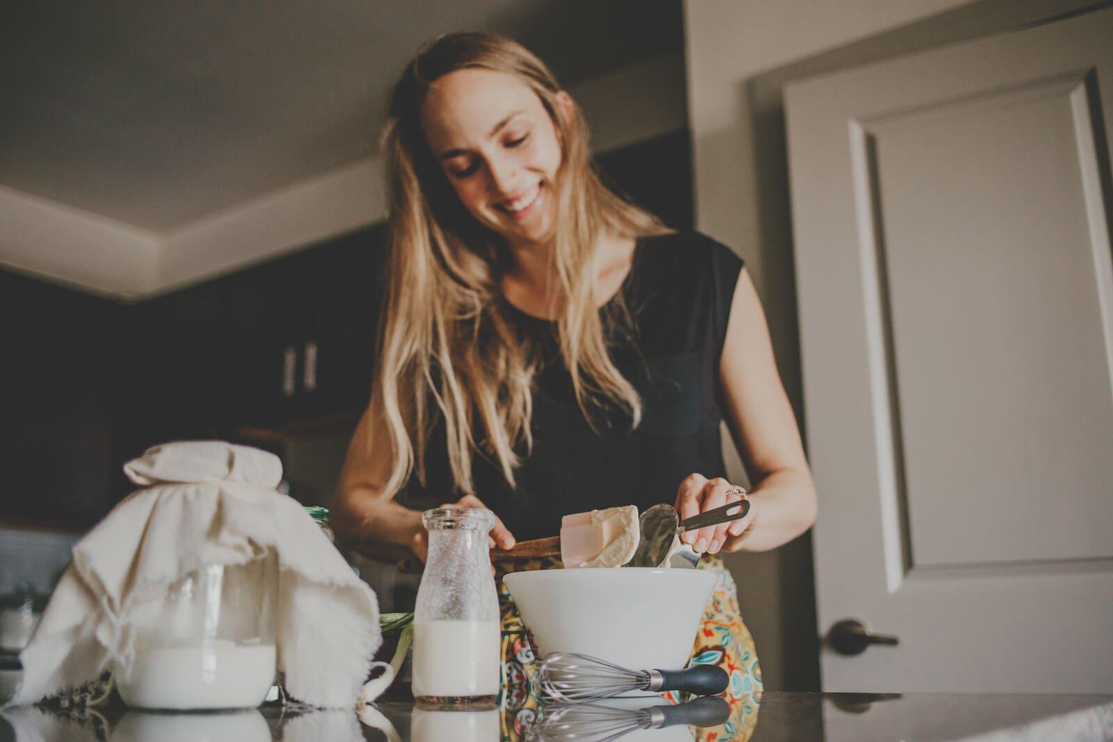 Multi strain probiotic: woman preparing food in her kitchen