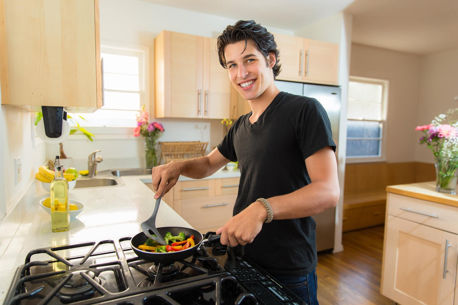 Person happily cooking at home