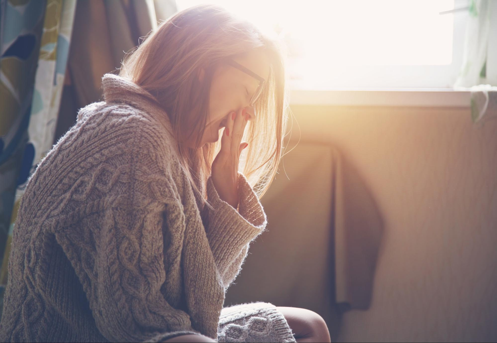 adrenal fatigue symptoms: Yawning woman with glasses