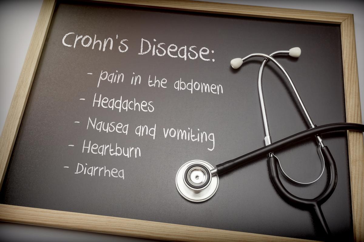 Crohns disease treatment: Crohn's disease symptoms written on a blackboard