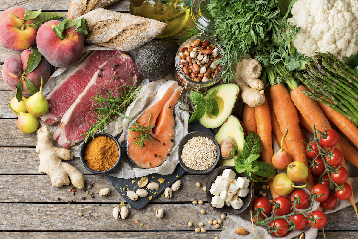 Various healthy food ingredients on a wooden surface