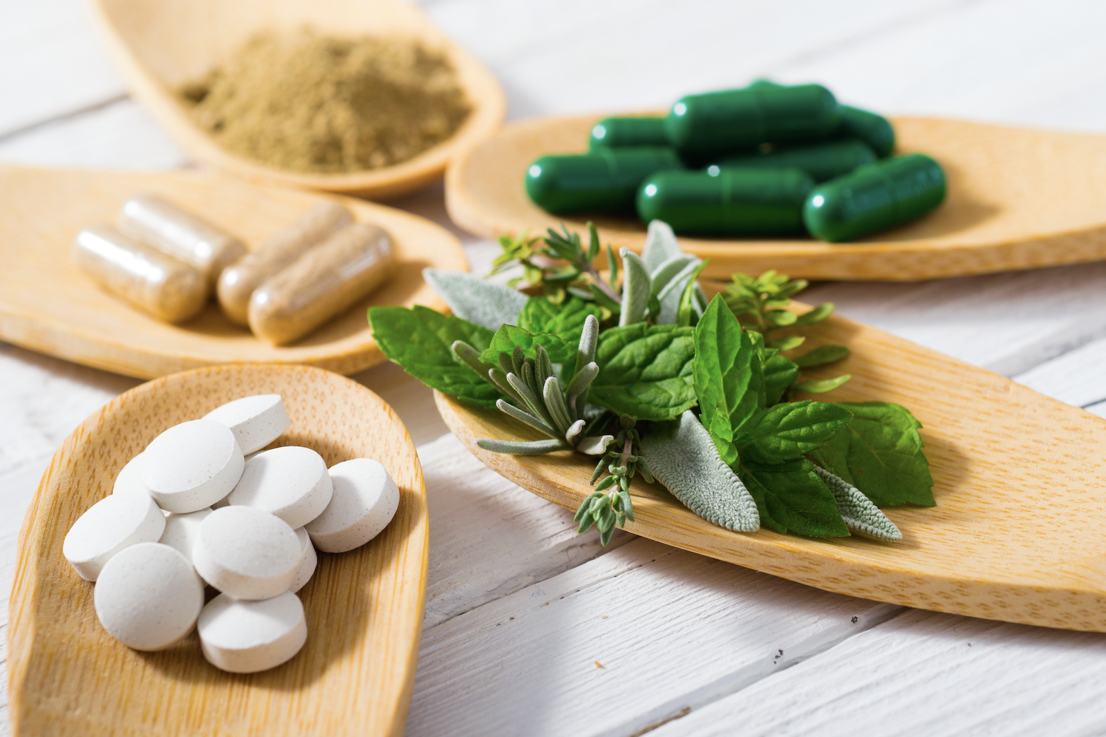Herbs and herbal medicine on wooden spoons