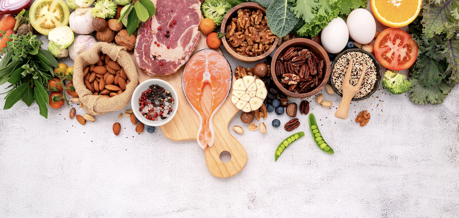 Autoimmune atrophic gastritis diet: Various healthy food ingredients on a dirty white surface
